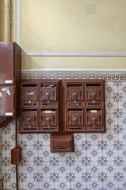 Lisbon, Portugal - February 14, 2015: Mailboxes on a tile wall in a building