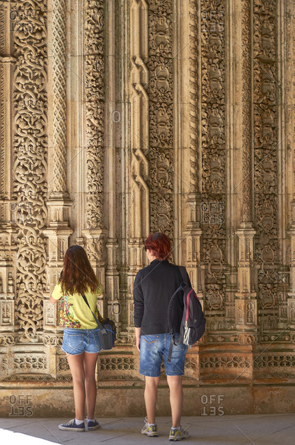 Batalha, Portugal - July 29, 2012: Tourists view carvings at the Capelas Imperfeitas