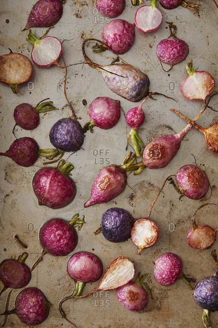 Roasted radishes on a baking pan