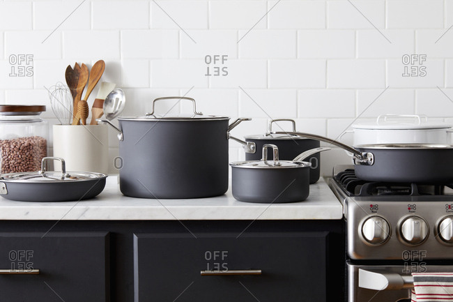 Pots and pans on a white marble counter
