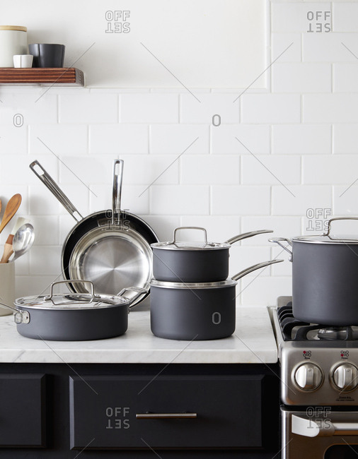 Pots and pans on a white kitchen counter