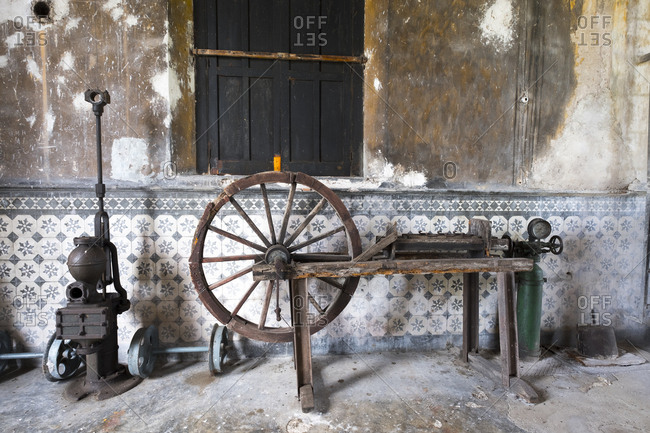 Yaxcopoil, Yucatan, Mexico - October 13, 2017: Old spinning wheel at Hacienda Yaxcopoil in the state of Yucatan in Mexico
