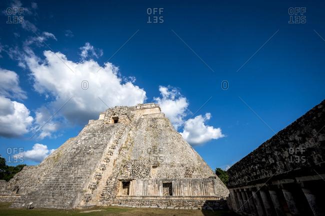 Uxmal, Yucatan, Mexico - October 13, 2017: Piramide del Mago towering in the Maya City of Uxmal, Mexico