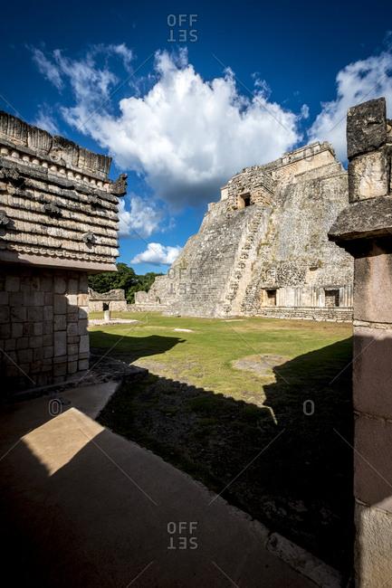 Uxmal, Yucatan, Mexico - October 13, 2017: The Pyramid of the Magician towering in the Maya City of Uxmal, Mexico
