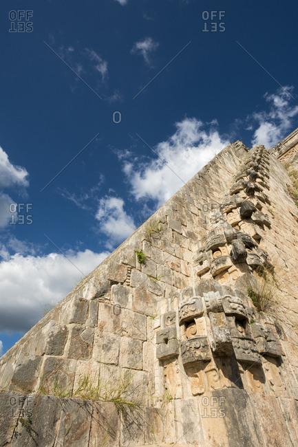 Uxmal, Yucatan, Mexico - October 13, 2017: Detail of the Pyramid of the Magician towering in the Maya City of Uxmal, Mexico