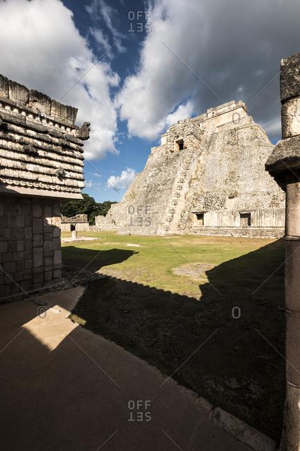 Uxmal, Yucatan, Mexico - October 13, 2017: Pyramid of the Magician towering in the Maya City of Uxmal, Mexico