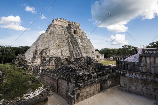 Uxmal, Yucatan, Mexico - October 13, 2017: Pyramid of the Magician in the Maya City of Uxmal, Mexico