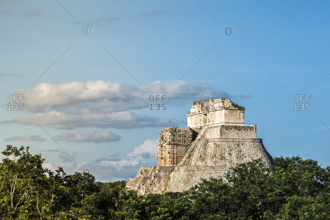 Uxmal, Yucatan, Mexico - October 13, 2017: The Pyramid of the Magician under cloudy skies in Uxmal, Mexico