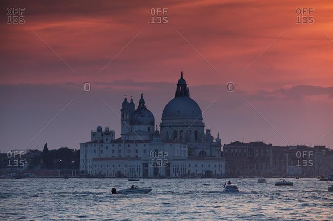 Venice, Italy - September 26, 2017: A dramatic sunset over the Roman catholic church, Santa Maria della Salute