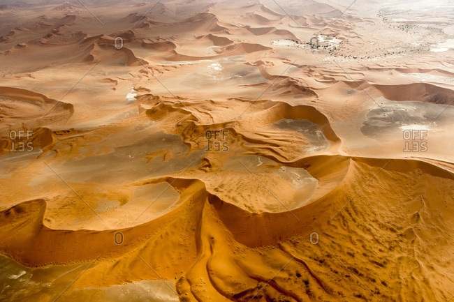 An aerial of the red sand dunes of the Namib Desert