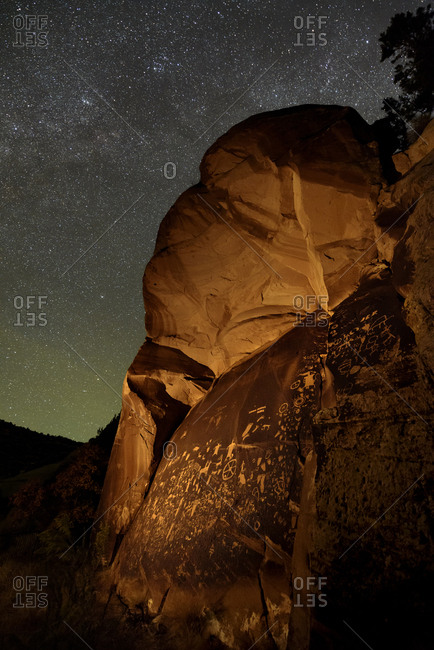 The Newspaper Rock under stars, one of the largest known panels of Native American petroglyphs