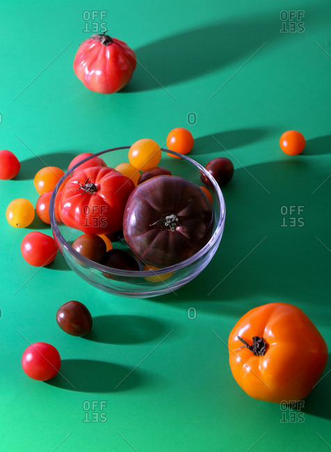 Bowl of multicolored tomatoes in studio