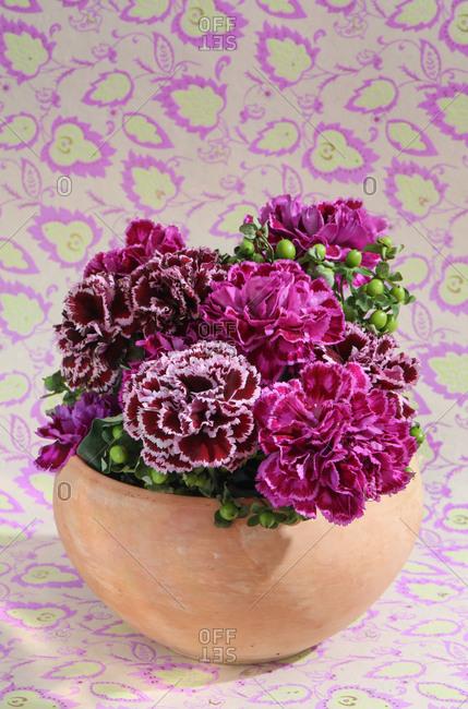 Fresh flower arrangement on whimsical background