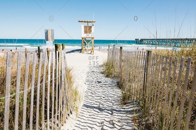 Beach path view of lifeguard stand and distant ocean