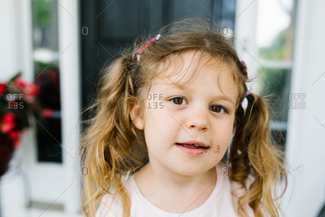 Cute portrait of little girl with smudges on her face