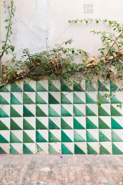 Geometric tile pattern in urban alleyway