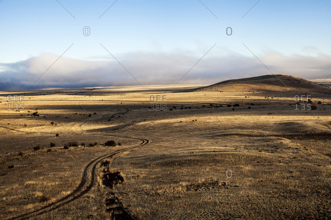 Deep shadows cast across desert-like farmland