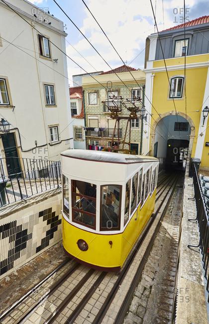 Lisbon, Portugal - November 10, 2016: Bica- Elevador da Bica- yellow cable railway