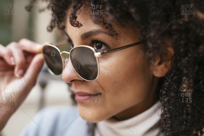 Portrait of smiling woman wearing sunglasses