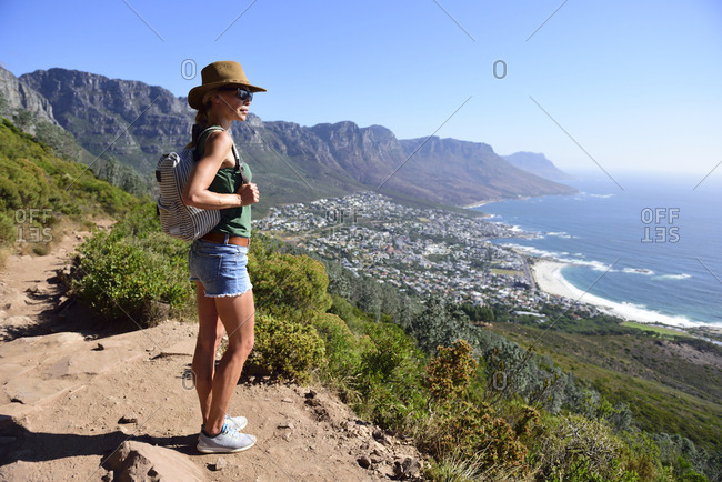 South Africa- Cape Town- woman standing looking at the coast during hiking trip to Lion\'s Head