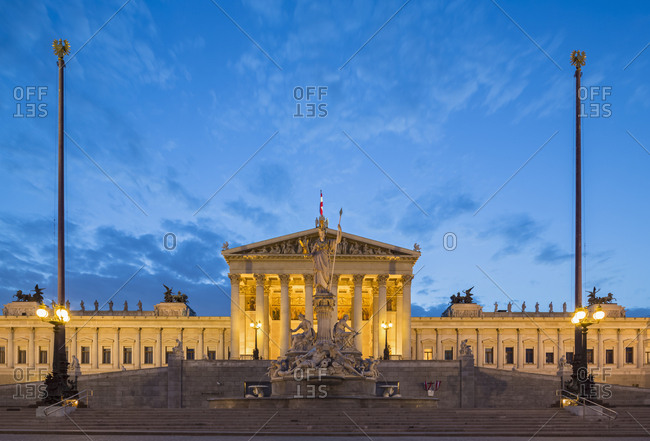 Austria- Vienna- view to parliament building with statue of goddess Pallas Athene in the foreground at blue hour