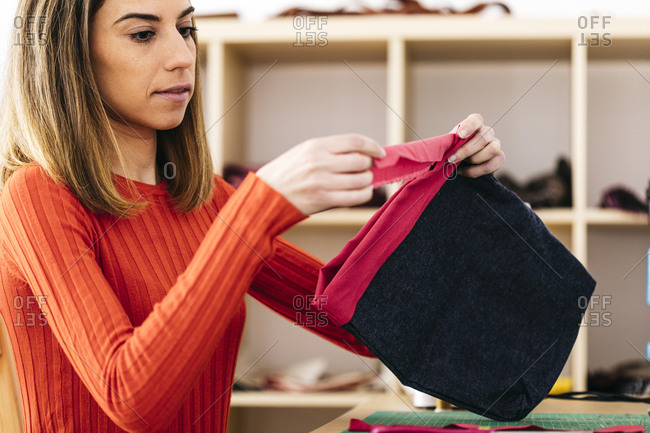 Fashion designer in studio designing a bag