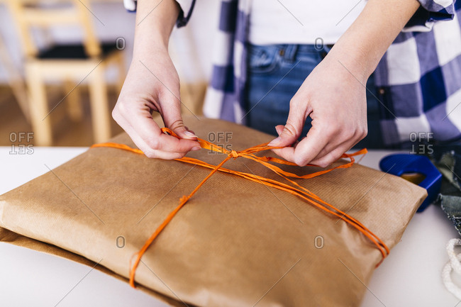 Close-up of woman wrapping a package