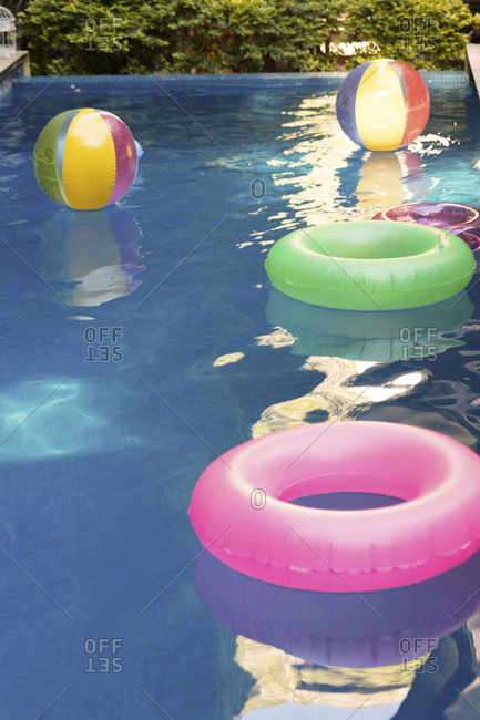Pooltoys floating on water in swimming pool