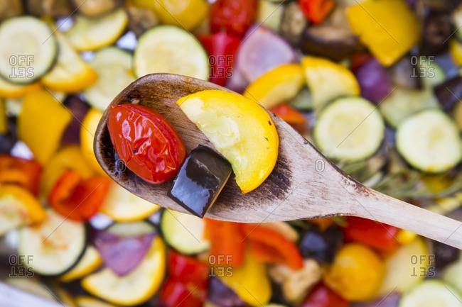 Mediterranean oven vegetables on wooden spoon