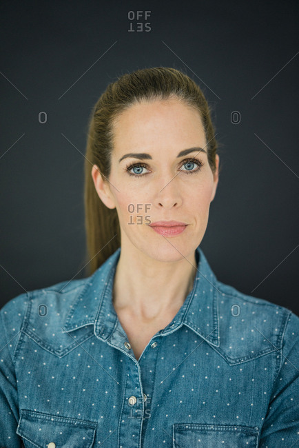Portrait of a beautiful woman against dark background