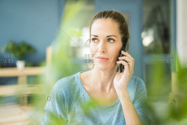 Woman talking on the phone in her new home