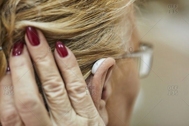 Close-up of senior woman with hearing aid
