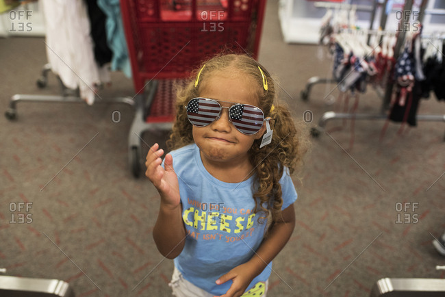 Little girl wearing American flag sunglasses