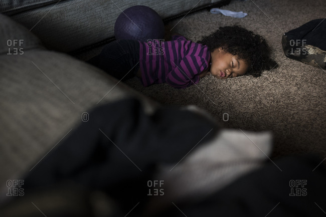 Little girl passed out on living room floor