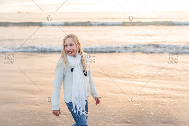 Portrait of a blonde girl on a beach at sunset