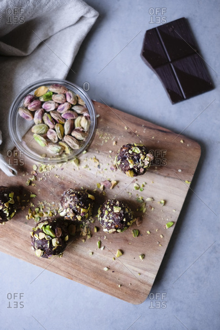 High angle view of chocolate pistachio truffle with ingredients on kitchen counter