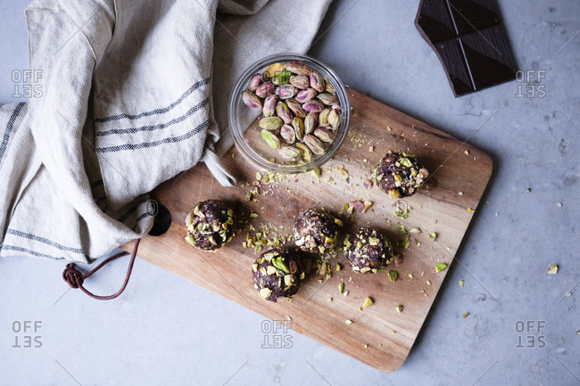 High angle view of chocolate pistachio truffle on cutting board at kitchen counter