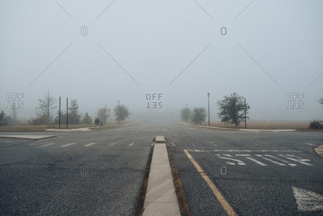 Empty cross roads in the fog