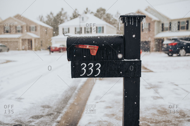 Icicles hanging off mailbox in suburban neighborhood