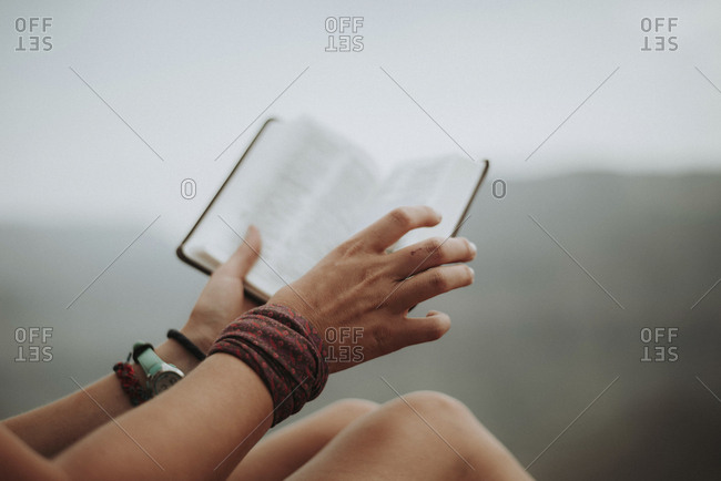 Cropped image of woman holding book at Grand Canyon National Park