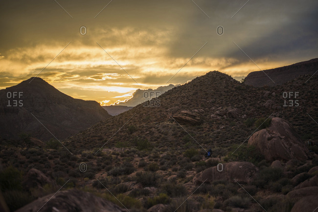 Scenic view of landscape against cloudy sky at Grand Canyon National Park during sunset