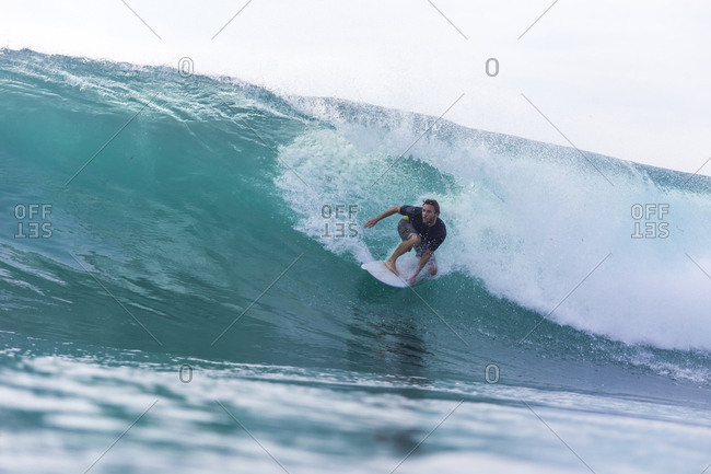 Water surface image of man surfing on sea against clear sky