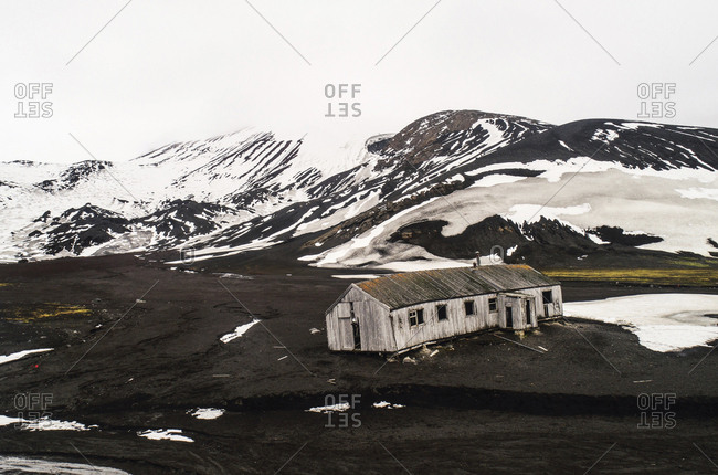 High angle view of abandoned house on landscape against sky during winter
