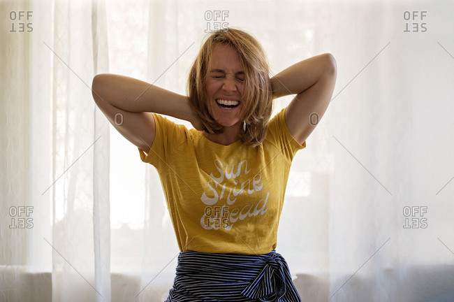 Happy blonde woman laughing