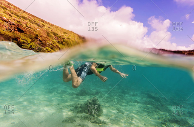 Underwater view of boy swimming in the ocean