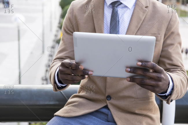 Cropped view of man holding tablet in Madrid, Spain