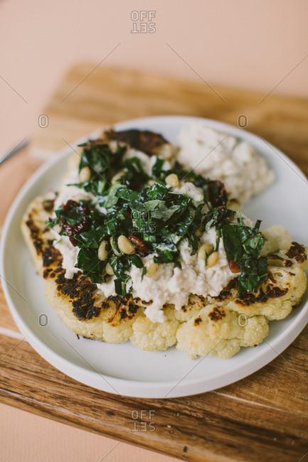 Fresh homemade cauliflower steak and vegan toppings