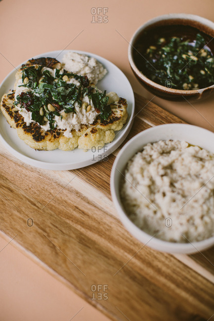 Single serving vegetarian dinner with cauliflower steak and side items