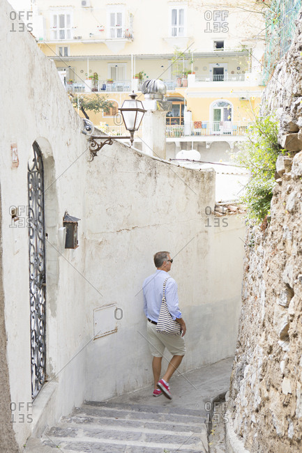 Person walking down outdoor stairs in Positano, Italy