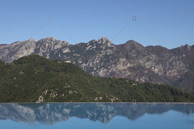 Scenic view of mountains along the Amalfi Coast of Italy reflected in infinity pool